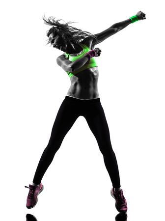 one caucasian woman exercising fitness zumba dancing  in silhouette  on white background