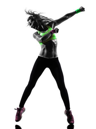 zumba: una mujer caucásica zumba fitness ejercicio bailando en silueta sobre fondo blanco Foto de archivo