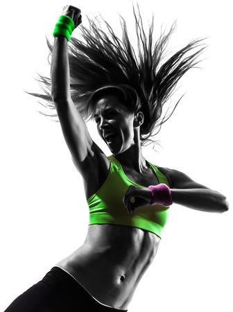1 つの白人女性を行使フィットネス ズンバの白い背景の上にシルエットで踊って 写真素材