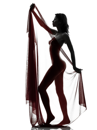 one beautiful asian woman naked behind red veil  in silhouette studio isolated on white background photo
