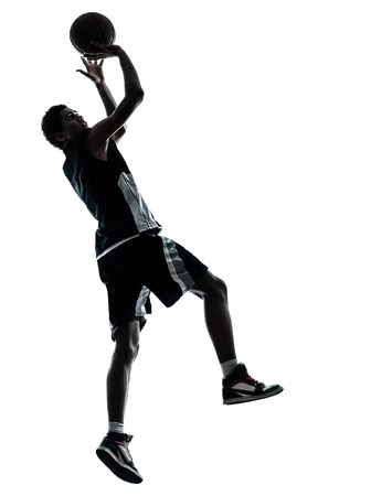 basketball player: one young man basketball player silhouette in studio isolated on white background Stock Photo