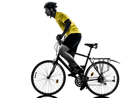 cut the competition: one caucasian man exercising bicycle mountain bike   on white background Stock Photo