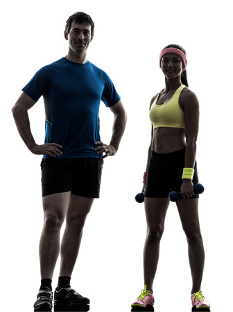 one  woman exercising fitness workout with man coach posing in silhouette  on white background photo