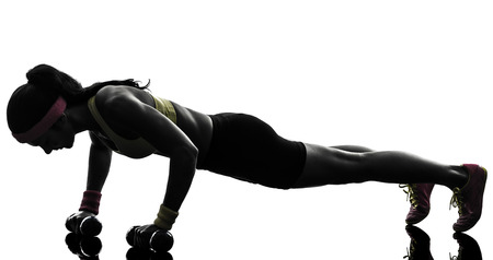 1: one  woman exercising fitness workout push ups  in silhouette  on white background