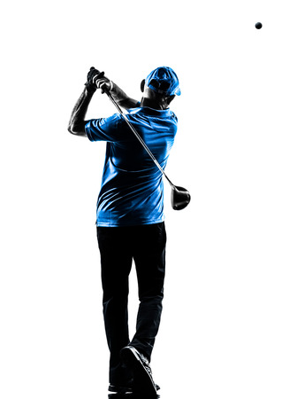 playing golf: one man golfer golfing golf swing in silhouette studio isolated on white background