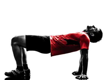 one man exercising fitness workout in silhouette on white background photo