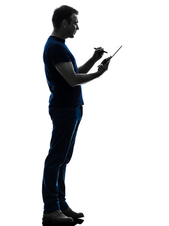 one caucasian man holding digital tablet   in silhouette on white background photo