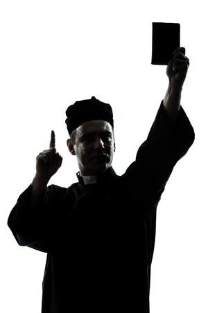 holding bible: one caucasian man priest wrath of god  silhouette in studio isolated on white background