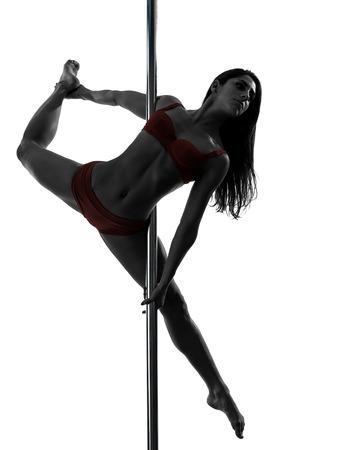 pole dancing: une femme caucasienne pole dancing danseur en studio silhouette isol? sur fond blanc Banque d'images