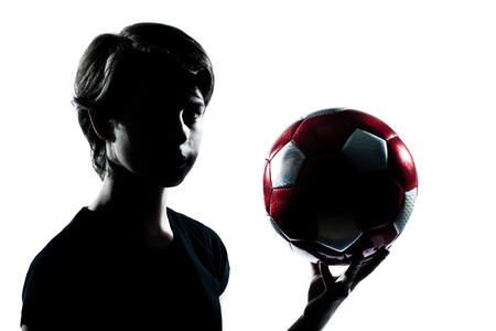 one caucasian young teenager silhouette boy girl holding showing soccer football portrait in studio cut out isolated on white background photo