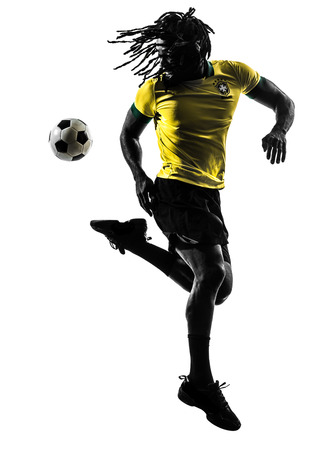 brazilian: one black brazilian soccer football player man in silhouette studio  on white background