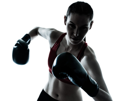 woman boxing gloves: one caucasian woman boxing exercising in silhouette studio  isolated on white background