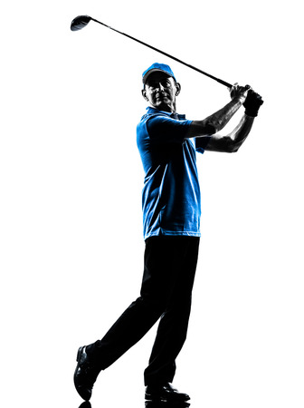 one man golfer golfing in silhouette studio isolated on white background photo