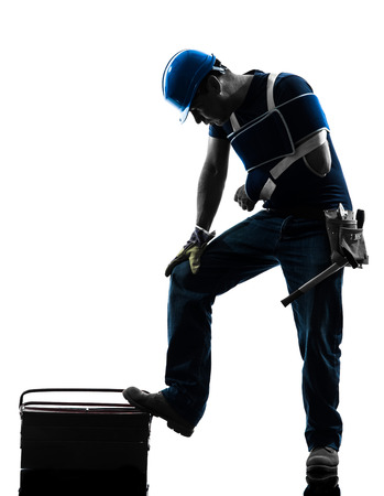 one  manual worker man in silhouette on white background photo
