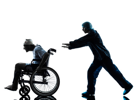 one  injured man in wheelchair  in silhouette studio  on white background Stock Photo - 22799331