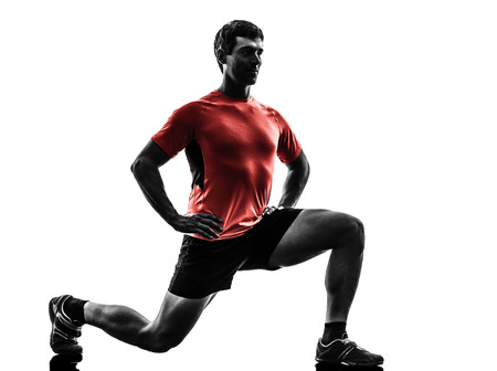 one man: one  man exercising fitness workout lunges crouching  in silhouette  on white background