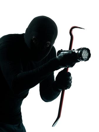 thief criminal burglar portrait masked  in silhouette studio isolated on white background photo