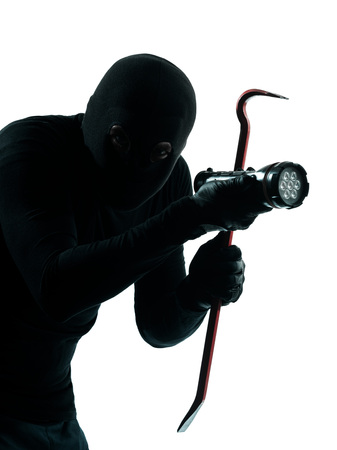 looting: thief criminal burglar portrait masked  in silhouette studio isolated on white background Stock Photo