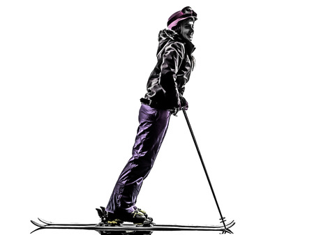 one caucasian woman skier skiing in silhouette on white background photo