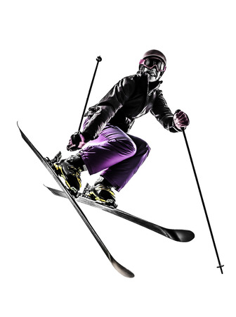skier jumping: one caucasian woman skier s freestyler  jumping in silhouette on white background Stock Photo