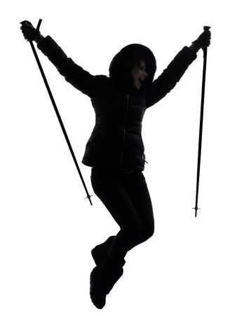 one  woman in winter coat hiker hiking  jumping happy  silhouette on white background photo