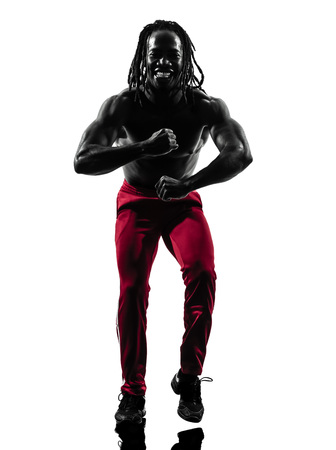 one african man exercising fitness zumba dancing  in silhouette  on white background photo
