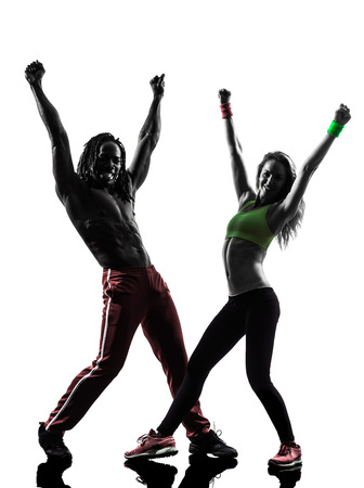 zumba: couple man and woman exercising fitness zumba dancing  in silhouette  on white background