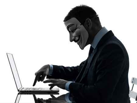 one man: Paris, France - October 30, 2012 : one man dressed and masked as a  member of Anonymous underground group member computing computer  on October 30, 2012 in Paris ,France