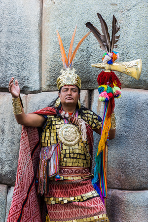cuzco: Cuzco, Peru - July 13, 2013: man disguised as Inca warrior  in the peruvian Andes at Cuzco Peru on july 13th, 2013