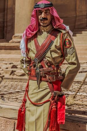 legion: Petra, Jordan - May 11, 2013 arab legion soldier portrait in nabatean petra jordan middle east