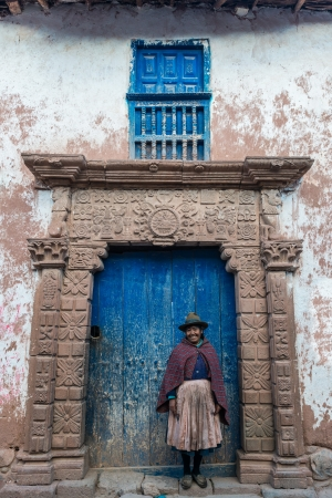 Moray, Peru - July 15, 2013: woman in front of ancient door in the peruvian Andes at Moray in Cuzco Peru on july 15, 2013 Stock Photo - 22792627