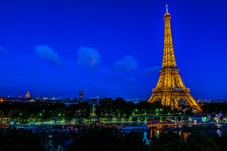 nightime: PARIS, FRANCE - JULY 14, 2009: The Eiffel Tower at night at the city of Paris in France on july 14th, 2009