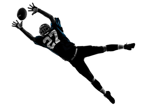 american football background: one caucasian american football player man catching receiving in silhouette studio isolated on white background