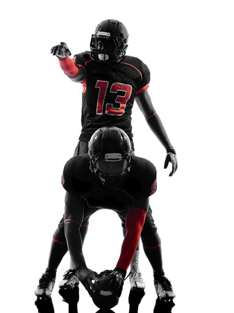 two american football players on scrimmage in silhouette shadow  white background photo