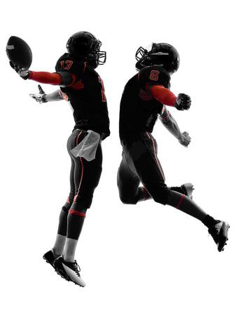 uniforme de futbol: dos jugadores de f�tbol americano de touchdown celebraci�n silueta sombra sobre fondo blanco Foto de archivo