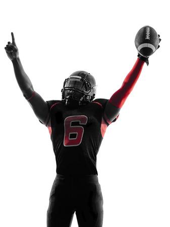 uniforme de futbol: un jugador de f�tbol americano retrato celebraci�n de touchdown en sombra de la silueta en el fondo blanco