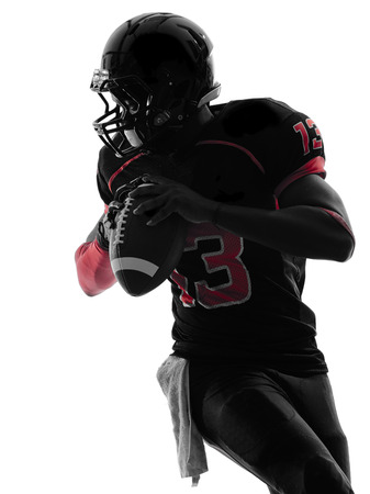 one  american football player quarterback  portrait in silhouette shadow on white background photo