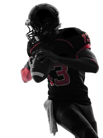 the football player: un jugador del f�tbol americano retrato en silueta sombra sobre fondo blanco