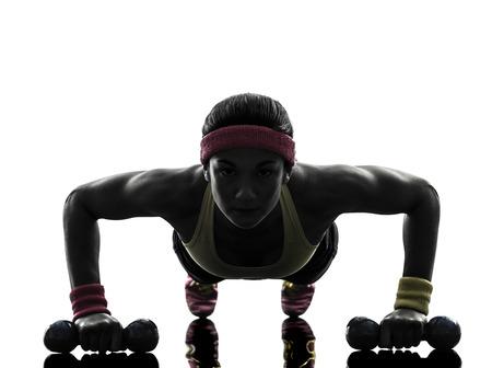一人の女性は白い背景にシルエット フィットネス トレーニング プッシュ アップを行使 写真素材