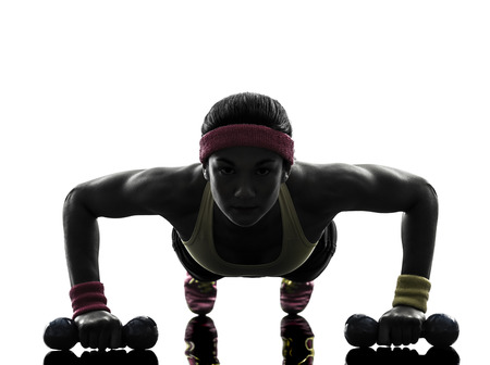 one  woman exercising fitness workout push ups  in silhouette  on white background photo