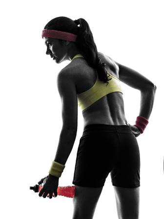 woman fitness: une femme l'exercice physique tenant boisson �nerg�tique en silhouette sur fond blanc Banque d'images