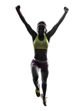 one caucasian woman runner running jumping  in silhouette on white background photo