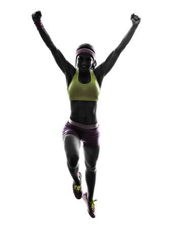 caucasico: una mujer cauc�sica running salto en la silueta en el fondo blanco