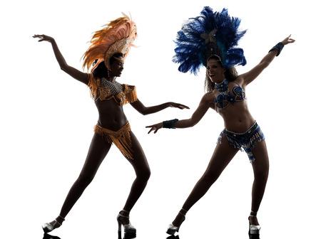 two women samba dancer  dancing silhouette  on white background photo