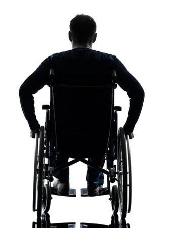 1 障害者男性リアビュー シルエット スタジオで白い背景の上 写真素材