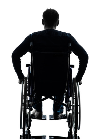 wheelchairs: one handicapped man rear view in silhouette studio  on white background