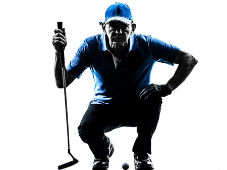 crouches: one man golfer golfing crouching in silhouette studio isolated on white background