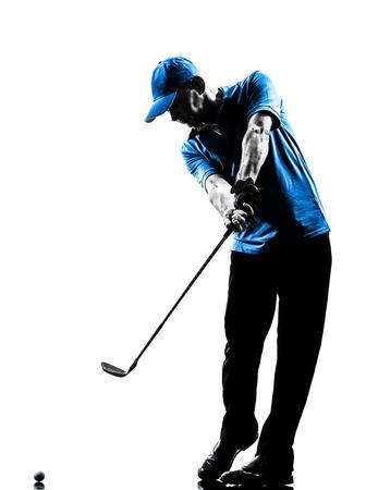 白い背景で隔離のシルエット スタジオで一人の男ゴルファーのゴルフ ゴルフのスイング