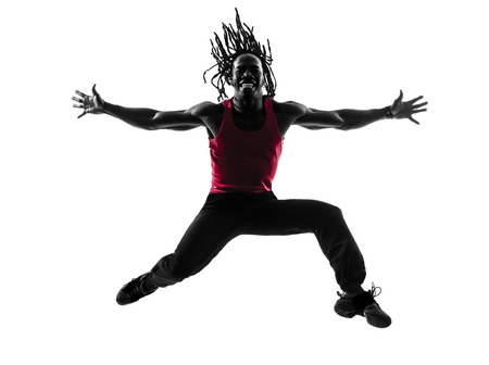 zumba: one african man exercising fitness zumba dancing  in silhouette  on white background