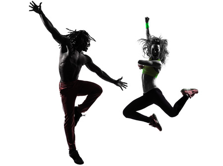 couple man and woman exercising fitness zumba dancing  in silhouette  on white background photo